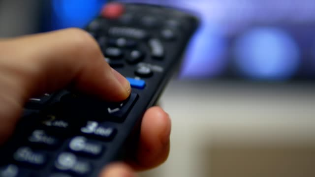 vídeos de stock e filmes b-roll de using remote controller to change the channel on television - dedo humano