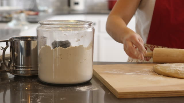 Using rolling pin to roll cookie dough video