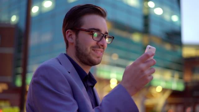 Using smartphone, city night. video