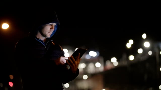 Using smartphone in the city at Night video