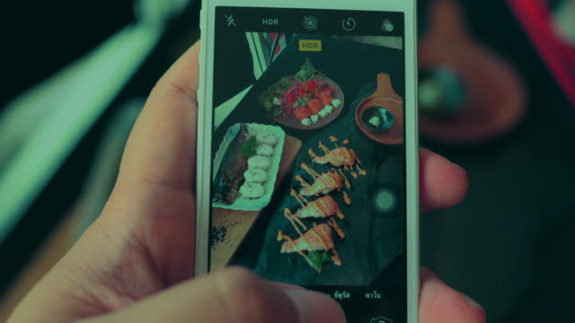 using smartphone taking photo of japanese food - sashimi video stock e b–roll