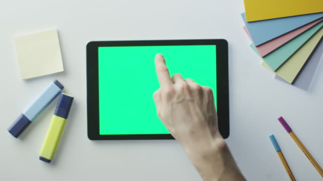 Using Tablet with Green Screen on Designer's Table. video