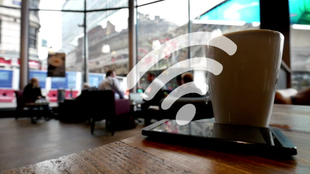 Using wifi in a coffee shop. video