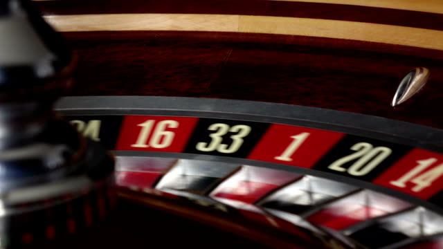 Usual roulette wheel running with white ball, side view video