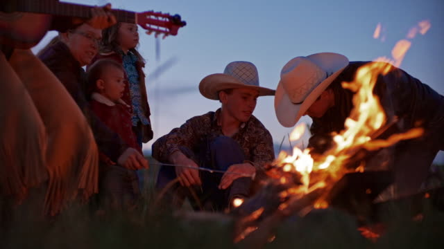 utah rancher family by the bonfire - ranch video stock e b–roll