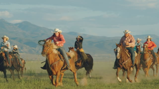 Utah ranchers galloping on horses
