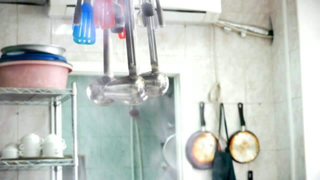 Utensils hanging on holder in a pair at the restaurant kitchen video