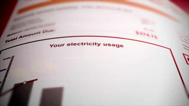 Utility Bill financial figures rising cost Utility bill close up. financial figures document. Struggling to pay finances. power stock videos & royalty-free footage