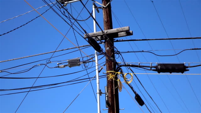 utility pole in slow motion - cavo d'acciaio video stock e b–roll