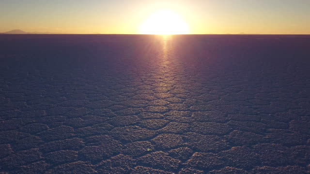 Uyuni salt flat in Bolivia Camera moves over the Uyuni salt flat in Bolivia during sunset, drone flight over Uyuni salt flat salt flat stock videos & royalty-free footage