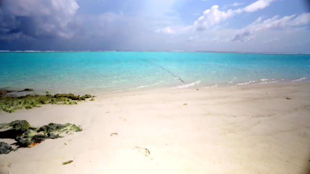 v00303 Maldives beautiful beach background white sandy tropical paradise island with blue sky sea water ocean 4k video