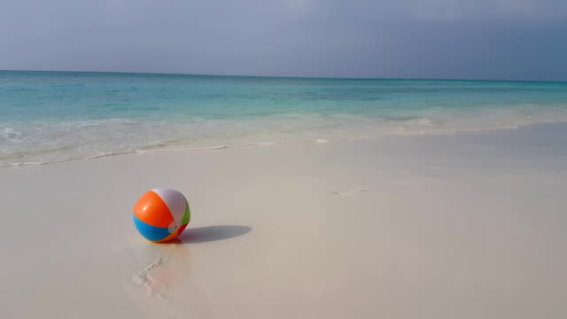 v01125 Maldives beautiful beach background white sandy tropical paradise island with blue sky sea water ocean 4k ball video