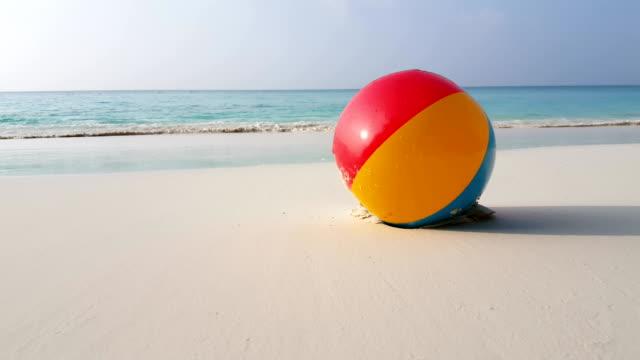 v01133 Maldives beautiful beach background white sandy tropical paradise island with blue sky sea water ocean 4k ball video