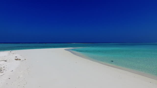 v01768 Maldives beautiful beach background white sandy tropical paradise island with blue sky sea water ocean 4k video