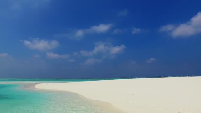 v02348 Maldives beautiful beach background white sandy tropical paradise island with blue sky sea water ocean 4k Maldives beautiful beach background white sandy tropical paradise island with blue sky sea water ocean 4k indian ocean islands stock videos & royalty-free footage