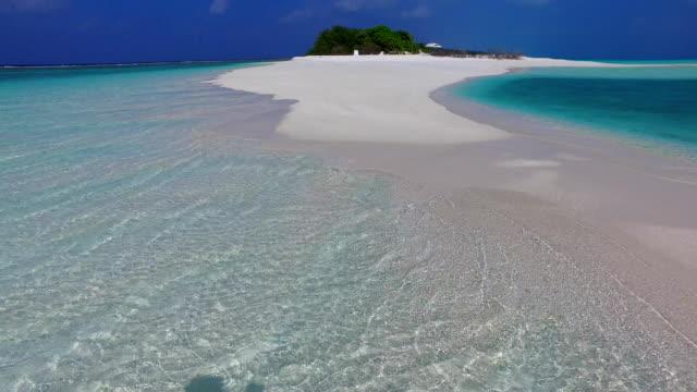 v02372 Maldives beautiful beach background white sandy tropical paradise island with blue sky sea water ocean 4k Maldives beautiful beach background white sandy tropical paradise island with blue sky sea water ocean 4k indian ocean islands stock videos & royalty-free footage
