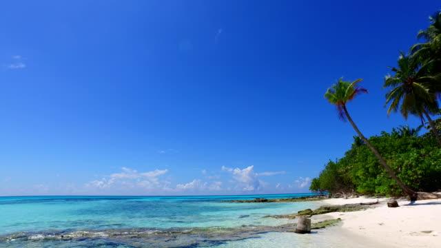 v02390 Maldives beautiful beach background white sandy tropical paradise island with blue sky sea water ocean 4k Maldives beautiful beach background white sandy tropical paradise island with blue sky sea water ocean 4k indian ocean islands stock videos & royalty-free footage