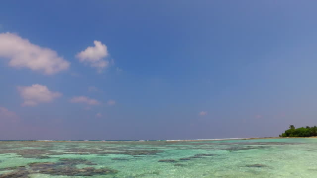 v02464 Maldives beautiful beach background white sandy tropical paradise island with blue sky sea water ocean 4k Maldives beautiful beach background white sandy tropical paradise island with blue sky sea water ocean 4k indian ocean islands stock videos & royalty-free footage