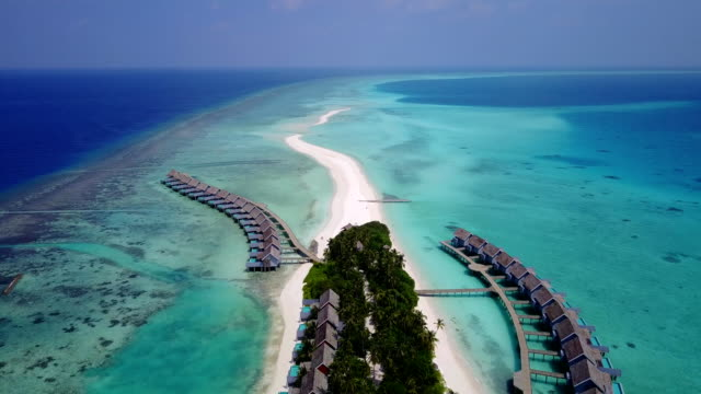 v03546 Aerial flying drone view of Maldives white sandy beach on sunny tropical paradise island with aqua blue sky sea water ocean 4k luxury 5 star resort hotel water bungalow hut relaxing holiday vacation video