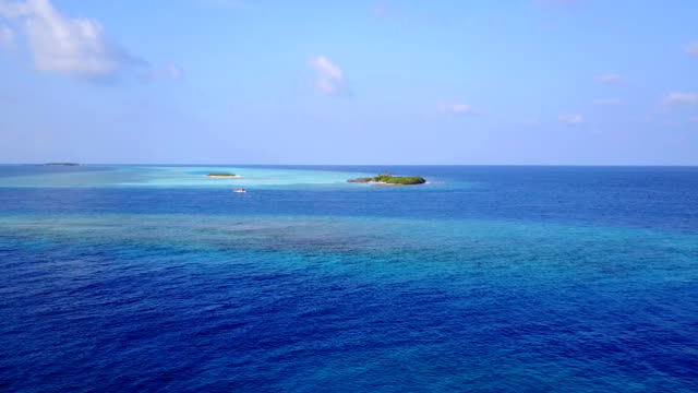 v04328 Aerial flying drone view of Maldives white sandy beach on sunny tropical paradise island with aqua blue sky sea water ocean 4k video