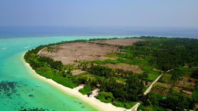 v04679 Aerial flying drone view of Maldives white sandy beach on sunny tropical paradise island with aqua blue sky sea water ocean 4k video