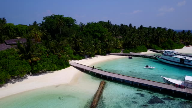 v05603 Aerial flying drone view of Maldives white sandy beach on sunny tropical paradise island with aqua blue sky sea water ocean 4k video
