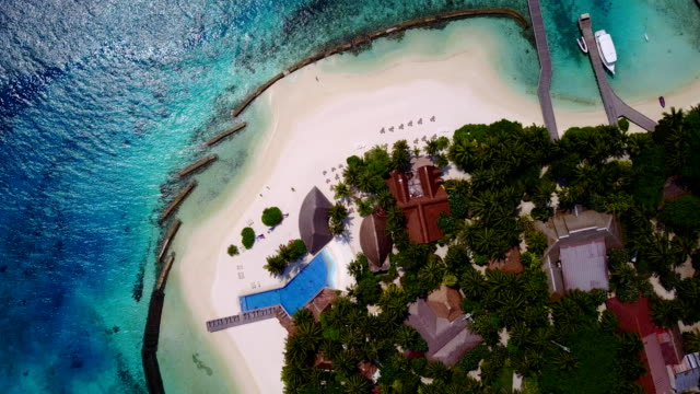 v06701 Aerial flying drone view of Maldives white sandy beach swimming pool in luxury 5 star resort hotel relaxing holiday vacation on sunny tropical paradise island with aqua blue sky sea ocean 4k video