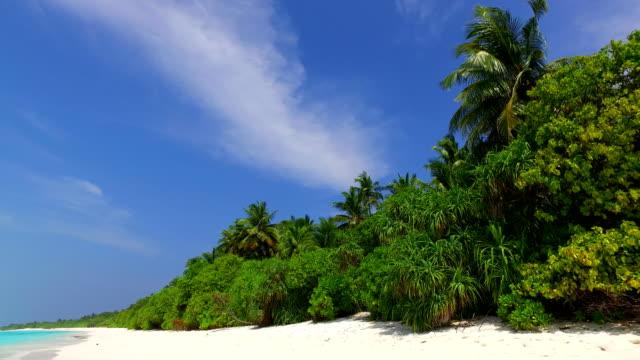 v07122 Maldives white sandy beach clouds on sunny tropical paradise island with aqua blue sky sea ocean 4k video