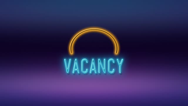 Vacancy Title Written on Neon Light Against Purple and Blue Background in 4K Resolution