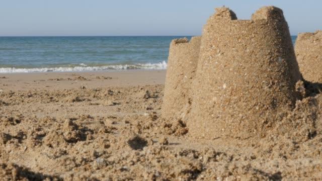 海のバカンス砂塔ビーチ夏テーマの背景 4 k - 城点の映像素材/bロール