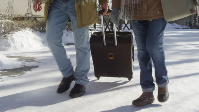 Vacationing Couple Arriving at Countryside Hotel in Winter