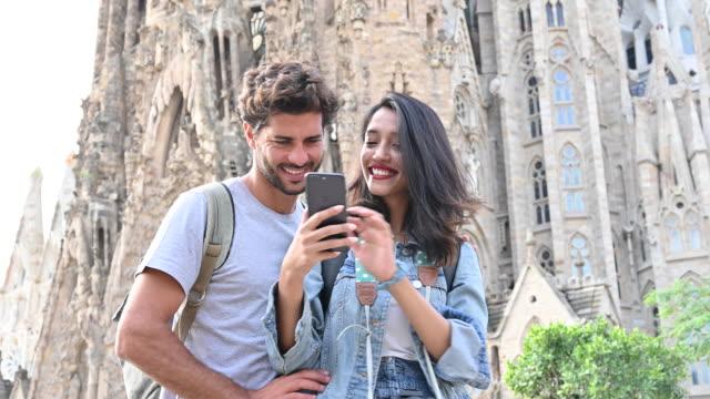 Vacationing Couple Taking Selfie at Sagrada Familia