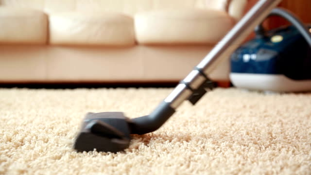 Vacuum cleaner cleaning the carpet, dolly shot Vacuum cleaner cleaning the carpet, dolly shot cleaning stock videos & royalty-free footage