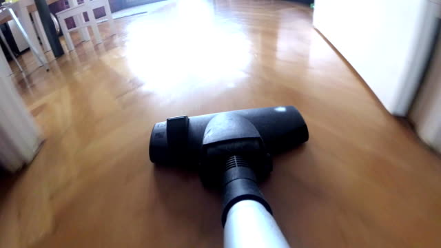 Vacuum Cleaner POV Hoovering Wooden Floor and Carpet video