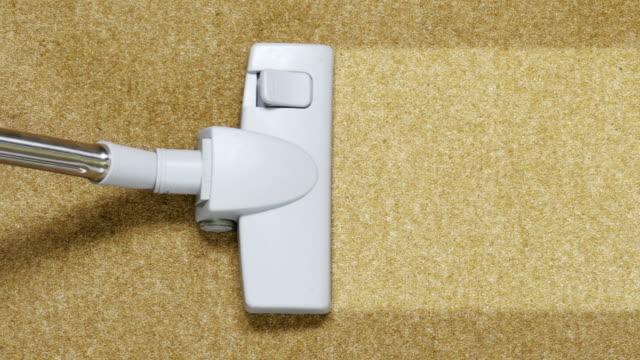 vacuum cleaning carpet close up video