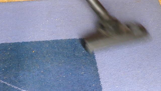 vacuuming blue carpet - moquette video stock e b–roll