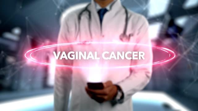 vajinal kanser - erkek doktor ile cep telefonu açar ve dokunuşlar hologram hastalık word - rahim boynu stok videoları ve detay görüntü çekimi