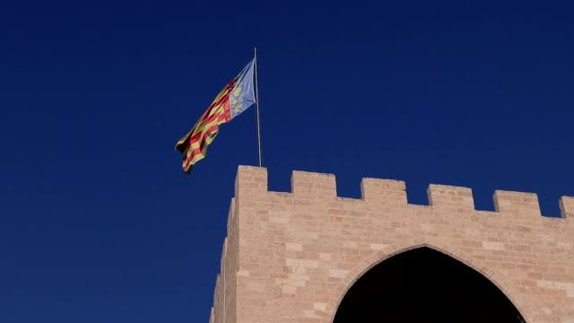 Valencia flag over castle - Stock Video Valencia The Serrans Gate or Serranos Gate, in Spain sorpresa stock videos & royalty-free footage