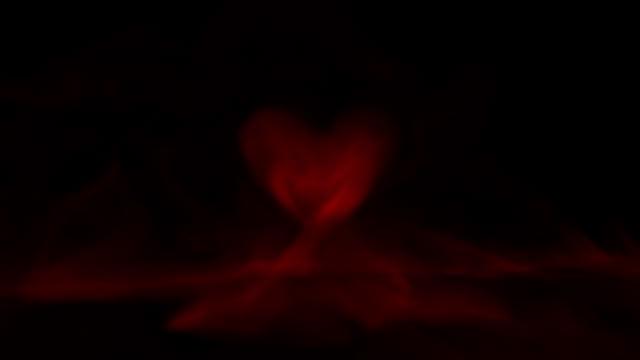 vidéos et rushes de la saint-valentin. fumée rouge du coeur. avec canal alpha. - coeur