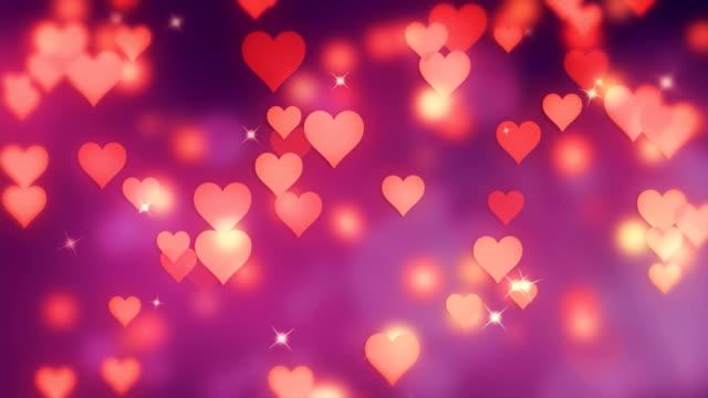 vidéos et rushes de 4k valentine floue rose coeurs fond loopable - picto urne