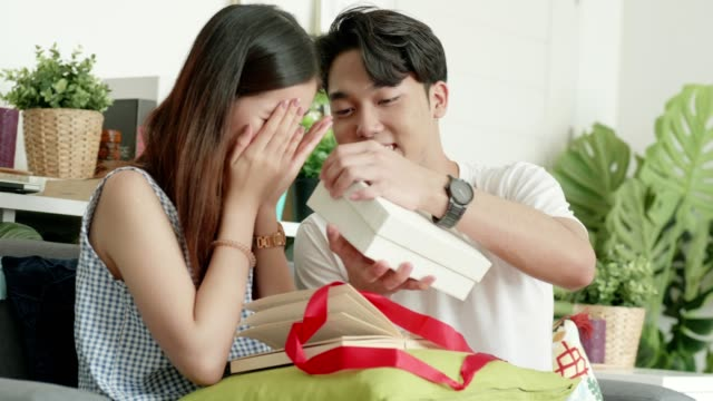 Valentine surprise:Thai man trying giving gift box for surprise to girlfriend for Valentine and birthday celebration