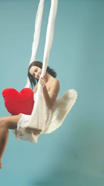 valentine's day angel with red heart sway - vertical format video stock videos and b-roll footage