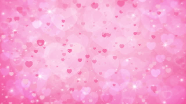 Valentines day falling hearts pink background Motion of beautiful bright circle bokeh and light ray over pink, Christmas and Happy New Year background valentines day stock videos & royalty-free footage