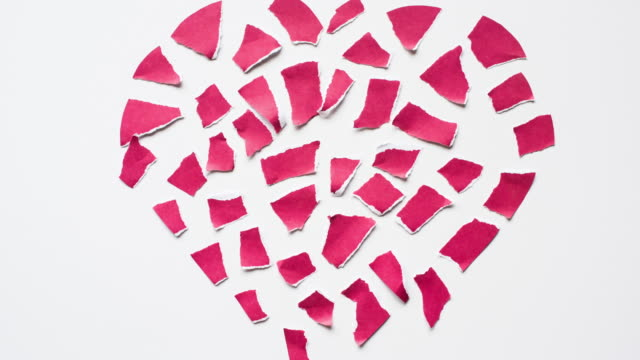 Valentine's Day Stop Motion Valentine's Day heart stop motion goes from a broken heart to a whole one. torn stock videos & royalty-free footage