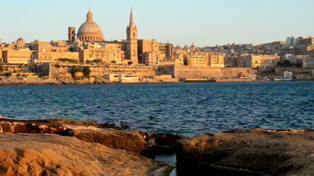 Valleta Malta View on Valetta across the sea. The main focus on St. Paul Shipwrecked Church and Church of St. Catherine malta stock videos & royalty-free footage