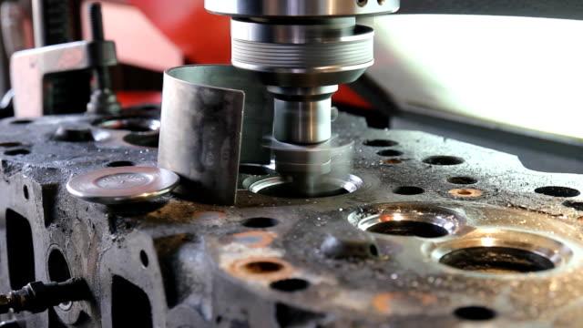 Valve seat grinding machine. video