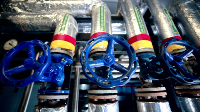 Valves, pipes, gauges at a Gas and oil production plant. Slider shot video