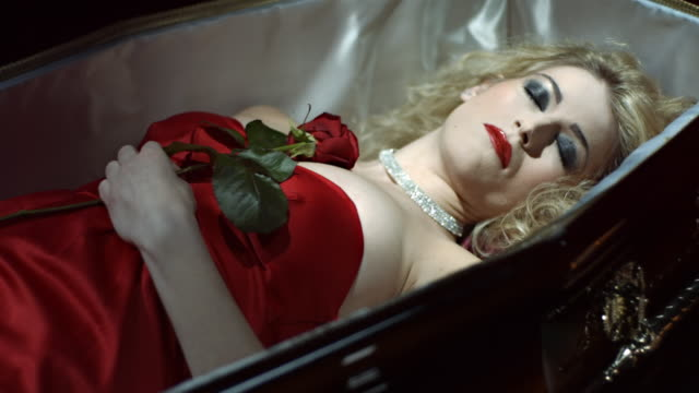 Vampire Awakening From Death Dolly slow motion shot of a beautiful vampire woman snarling at camera after awakening from death in a coffin. Recorded at 96 fps. vampire stock videos & royalty-free footage