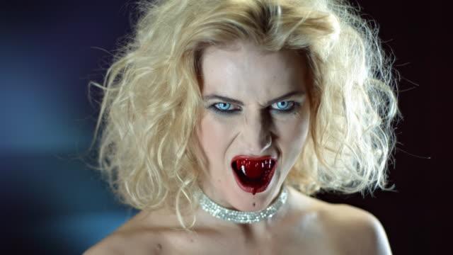 stockvideo's en b-roll-footage met vampier bloeden uit de mond - halsketting