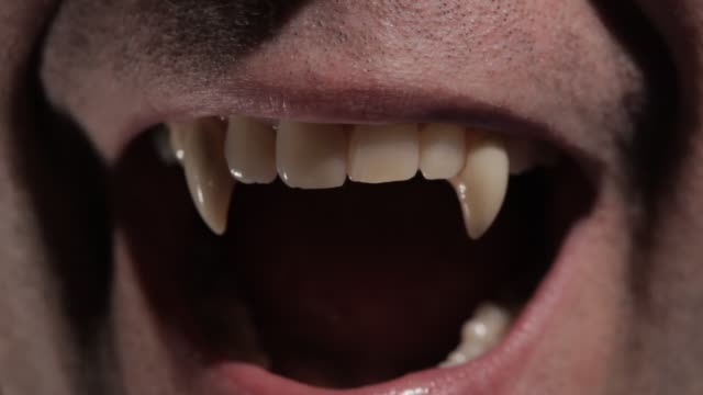 Vampire Sows His Fang A vampire shows his clean fang tohis next victim vampire stock videos & royalty-free footage